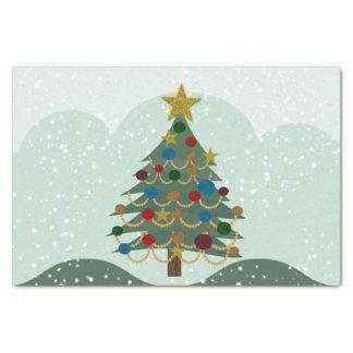 Árbol de navidad con la estrella, los bulbos y la papel de seda