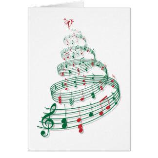 Árbol de navidad con las notas de la música tarjeta de felicitación