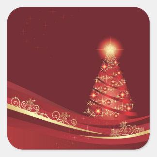 Árbol de navidad en un pegatina rojo del