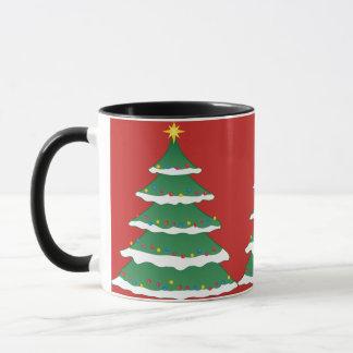 Árbol de navidad nevoso festivo con la taza de los