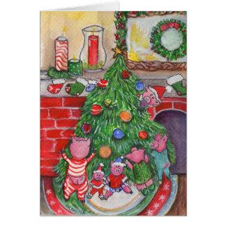 Árbol de navidad que adorna con los cochinillos tarjeta de felicitación