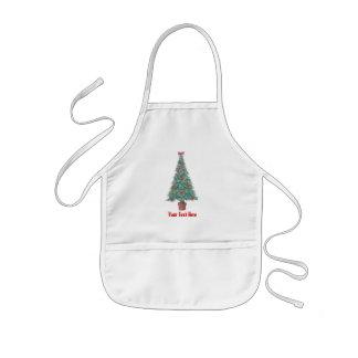 Árbol de navidad y decoraciones y arcos del rojo delantal infantil