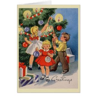 Árbol del vintage que adorna la tarjeta de Navidad