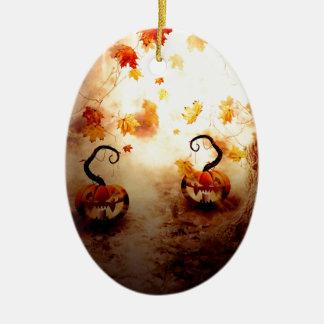 Árbol y calabaza fantasmagóricos adorno navideño ovalado de cerámica