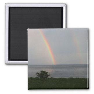 Arco iris doble sobre el océano imanes