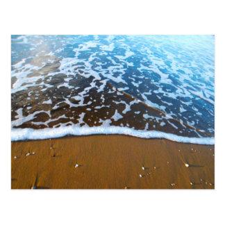 Arena y postal del mar