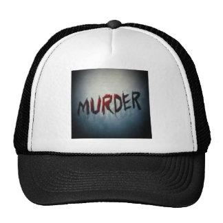 asesinato gorras