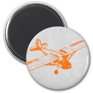 Avión anaranjado imán redondo 5 cm