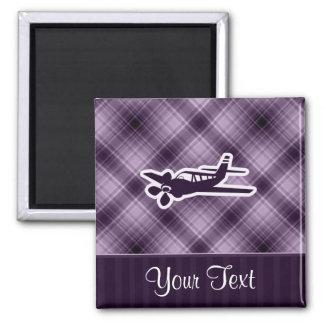 Avión púrpura imán