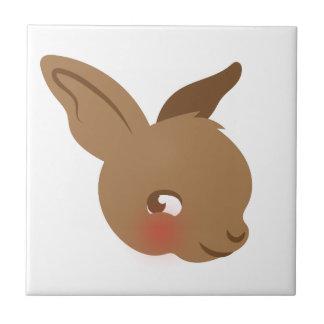 Azulejo cara marrón del conejo del bebé