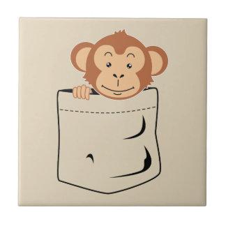 Azulejo Mono en bolsillo
