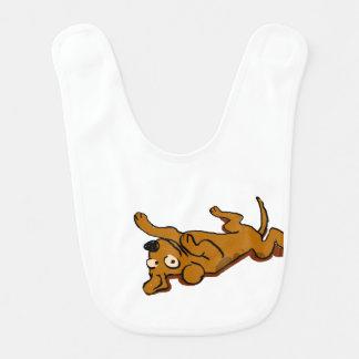Babero El perro feliz del dibujo animado se está