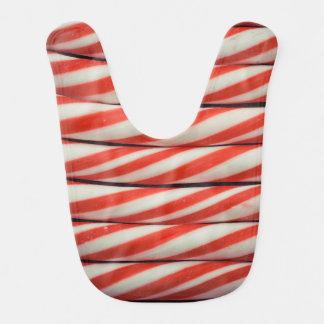 Babero Regalo rojo rayado del navidad blanco del bastón