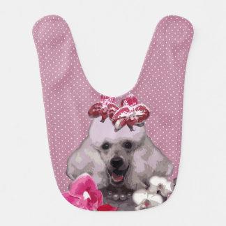 Babero rosado del bebé del caniche