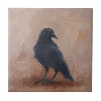 Baldosa cerámica con el cuervo