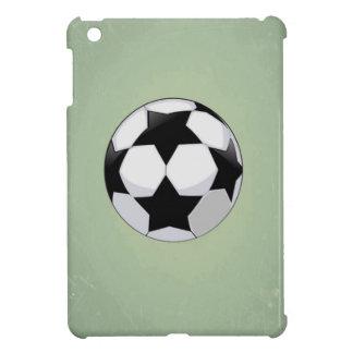 Balón de fútbol y fondo verde del vintage