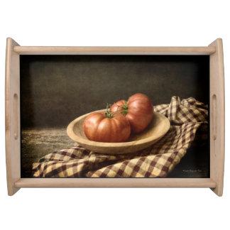 Bandeja Dos tomates rojos en un cuenco
