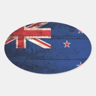 Bandera de madera vieja de Nueva Zelanda Pegatina Ovalada