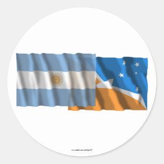 Banderas que agitan de la Argentina y de Tierra Pegatina Redonda