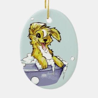 Baño de burbujas del perrito adorno para reyes