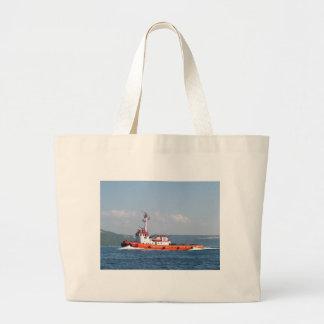 Barco anaranjado del tirón bolsas