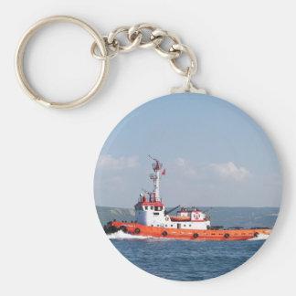 Barco anaranjado del tirón llavero redondo tipo chapa