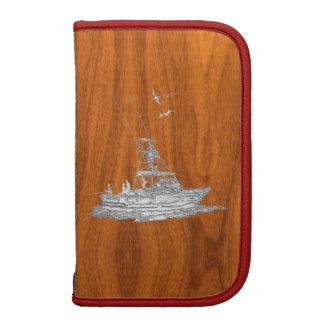 Barco de pesca del cromo en la madera de la teca planificador