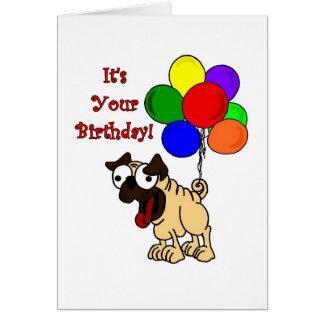 Barro amasado con la tarjeta de cumpleaños de los