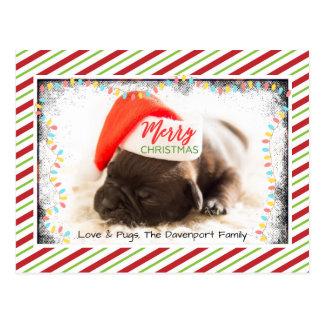 Barro amasado del navidad en el gorra de Santa con Postal