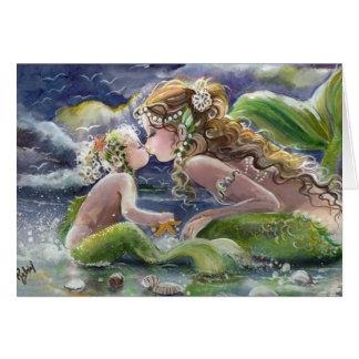 Besar la tarjeta de la sirena y del niño