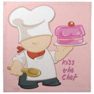 Bese las servilletas del paño del cocinero (fije