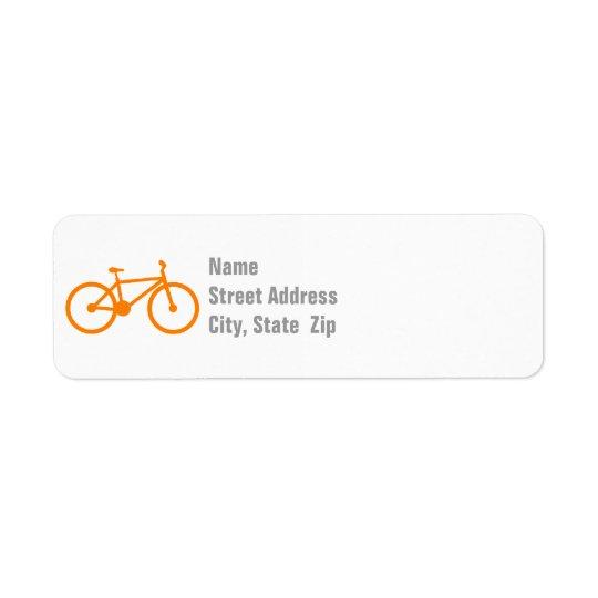 Bicicleta anaranjada etiqueta de remite