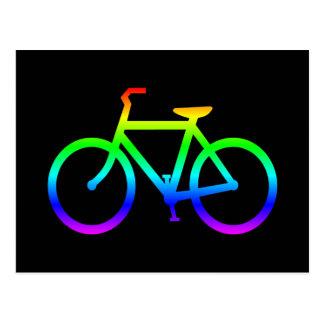 Bicicleta brillante del arco iris postal