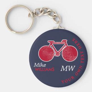 biking, bici roja en llavero azul con nombre