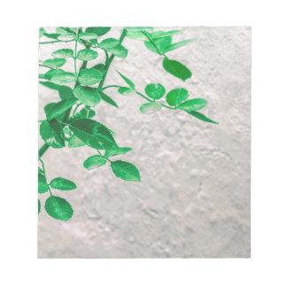 Bloc De Notas Plantas sobre la foto de la pared