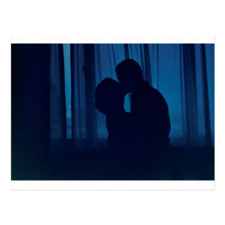 Blue silhouette couple kissing analogue film photo postal