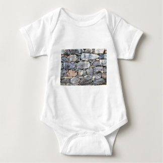 Body Para Bebé Backgound de piedras naturales como pared