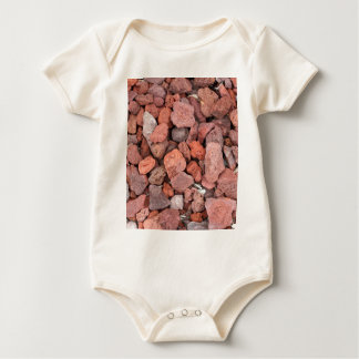 Body Para Bebé Cubierta de tierra roja de las rocas volcánicas