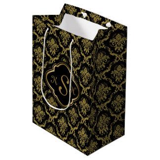 Bolsa De Regalo Mediana Oro con monograma y modelo floral negro de los