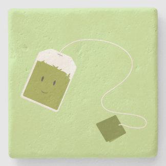 Bolsita de té verde sonriente posavasos de piedra