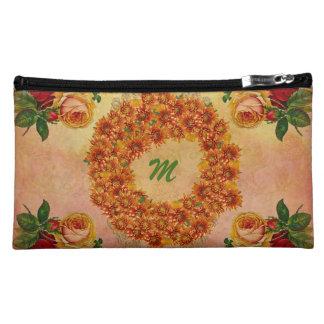 Bolso cosmético del ante floral del monograma para