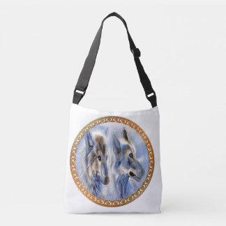 Bolso Cruzado Lobos azules y blancos del hielo que buscan la