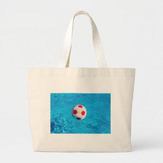 Bolso De Tela Gigante Pelota de playa que flota en piscina azul
