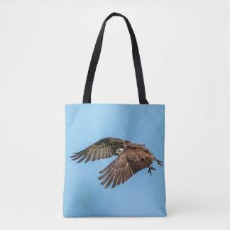 Bolso De Tela Osprey en vuelo en el parque de isla estado de la