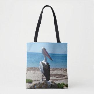 Bolso De Tela Pelícano en roca de la playa,