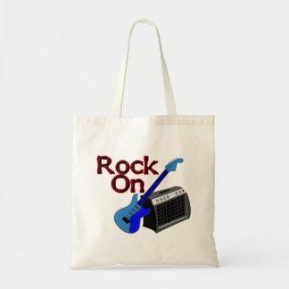 Bolso De Tela Roca en la guitarra y el amperio