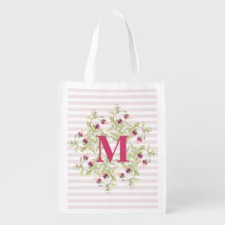 Bolso reutilizable del monograma floral rosado