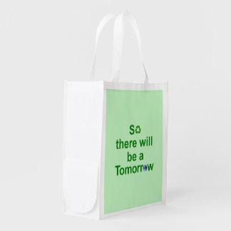 Bolso reutilizable verde claro con el texto