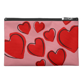 Bolso rosado con los corazones rojos