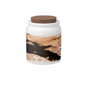 Borde del camino de la nutria de la erosión de la  jarra para caramelo